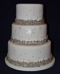 winter wedding cakes ivory and silver wedding cake covered in