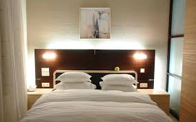 headboard lighting ideas beautiful soft purple wall patterned bedroom light ideas black