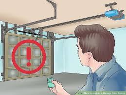 How To Adjust A Craftsman Garage Door Opener by How To Adjust A Garage Door Spring With Pictures Wikihow