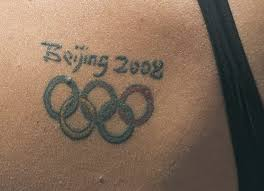 calling all swimmers with the olympic rings tattoo