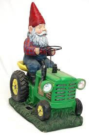 large 25 pound solar powered garden gnome on tractor