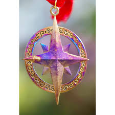 compass ornament with ribbon from war to peace