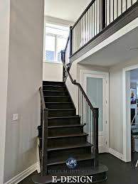 black staircase benjamin moore collingwood in a staircase with dark wood stair