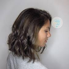 dark brunette with balayage highlights and long angled bob haircut