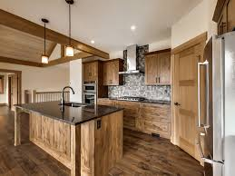 stained kitchen cabinets with hardwood floors engineered hardwood floors alder cabinets