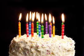 birthday cake candles birthday cake and candles on black background stock photo image