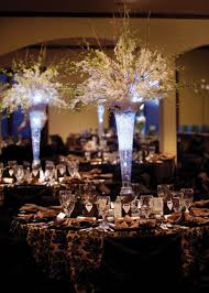 tall wedding centerpieces but with a deep purple light in