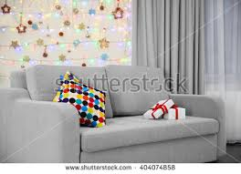 light grey couch pillows on christmas stock photo 404074858