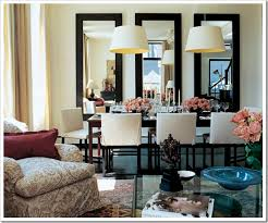 ad dining room two chandeliers three mirrors peach roses