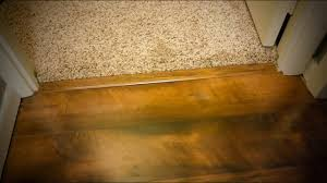 how to install transition carpet and hardwood on concrete