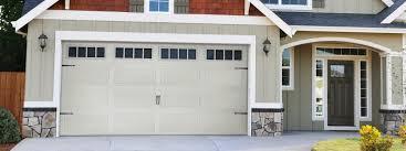 trendy black roof tile garage doors and white wooden doors for