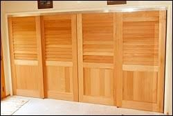 bifold doors or sliding closet doors which cost less