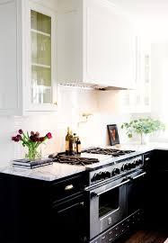 Black Cabinets White Countertops These 7 Stunning Kitchens Make The Case For Black Cabinets Mydomaine