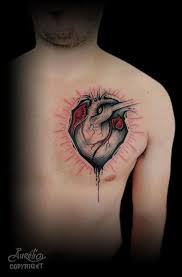 heart tattoo by belly button tattoo