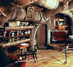 ornate bookshelves and massive pipes love this steampunk style