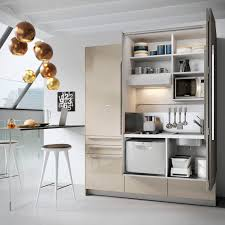 compact kitchen hidden with swing doors by minisystem casas