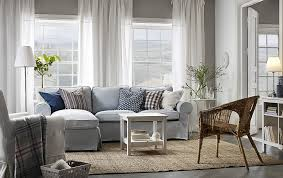 a light living room furnished with a light blue two seat sofa with
