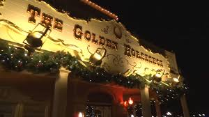 christmas decorations in frontierland nighttime view at disneyland