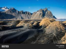 Volcanic Sand Mountains And Volcanic Lava Sand Dunes By The Sea In Stokksness