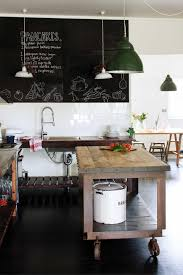 industrial metal and wooden topped kitchen island on oversized