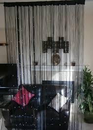 peculiar black premium heavyweight room divider curtains closed