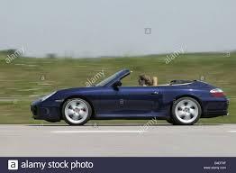 porsche side view car porsche carrera 4s convertible blue open top driving
