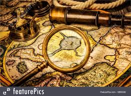 Ancient Map Picture Of Vintage Magnifying Glass Lies On The Ancient Map