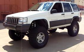 old white jeep cherokee jeep grand cherokee 4x4 project zj part 17 plastic trim mothers