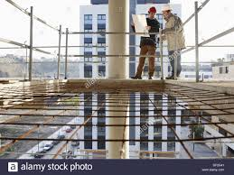 housing blueprints architect and construction worker looking at blueprints personal
