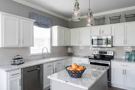 colored kitchen cabinets with stainless steel appliances how to decorate around stainless steel appliances