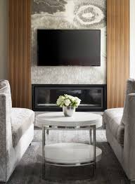 an elegant calgary home inspired by big sky country western living a sophisticated yet tranquil sitting room in the master suite allows the owners to cozy up by the black onyx clad fireplace