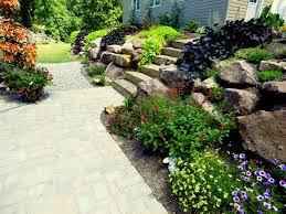 creating beauty and structure with a rock wall garden garden therapy