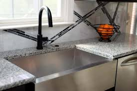 black faucet with stainless steel sink kitchen with stainless steel sink and black faucet using an