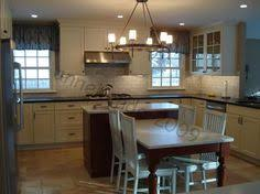 table islands kitchen image result for kitchen island with table height seating two level