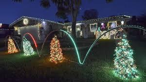 Amber Christmas Lights Secret Of U0027show Off U0027 Sign Next Door To Famed Holiday Lights Show