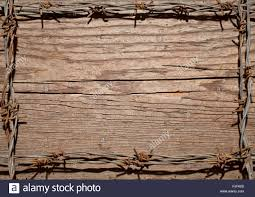 frame made of barbed wire on wooden desk stock photo royalty free