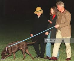 washington dc thanksgiving us president bill clinton r with his dog buddy pictures getty