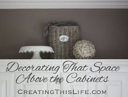 How To Decorate Above Cabinets by That Space Above The Cabinets Creating This Life