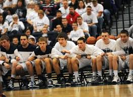 basketball player on bench dealing with lack of playing time coach s clipboard basketball