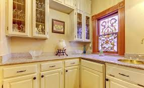 stained glass windows for kitchen cabinets kitchen area with marble top cabinets and stained glass window 112881508