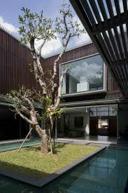 modern house with water surrounded courtyard in the center