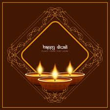 three candles for diwali on a brown background with ornaments