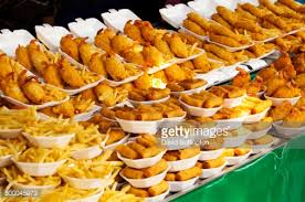 plates of fried food for sale in market stock photo getty images