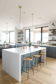 best 25 modern bar stools ideas on pinterest bar stool bar modern kitchen with deep walnut open shelves natural wood bar stools and white waterfall edged