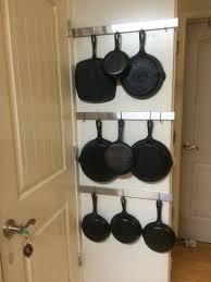 cast iron pan rack on the wall behind the door ikea rimforsa