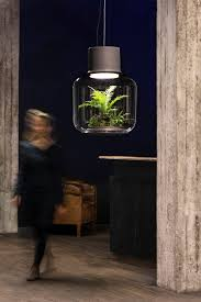lamp mygdal from nui studio allows plants to grow without sunlight