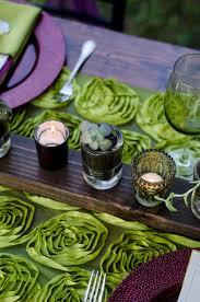 a fancy purple and green halloween tablescape fleur de lis event