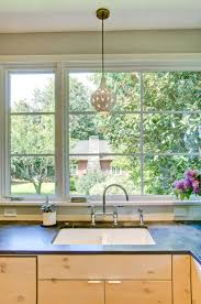 modern renovations of 19th century homes dwell farmhouse home remodeling pics from portland seattle modern farmhouse sink and pendant light in remodel target home decor