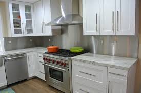 white kitchen cabinets with stainless steel backsplash stainless steel backsplash with trim transitional