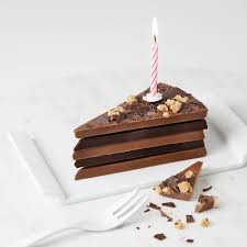 40th birthday chocolate cake slice with candle and card by quirky